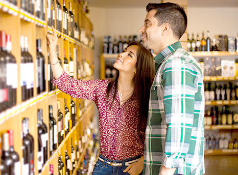 People browsing bottles of wine