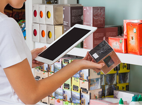 A shopper scanning a product with a tablet