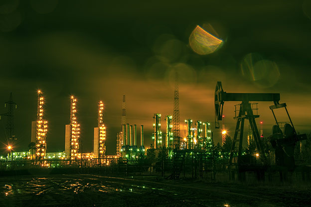 An oil plant lit at night